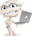 Little Mummy Kid Cartoon Vector Character AKA Fiddo the Mummy Kiddo - Holding a Laptop