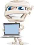 Little Mummy Kid Cartoon Vector Character AKA Fiddo the Mummy Kiddo - With a Computer